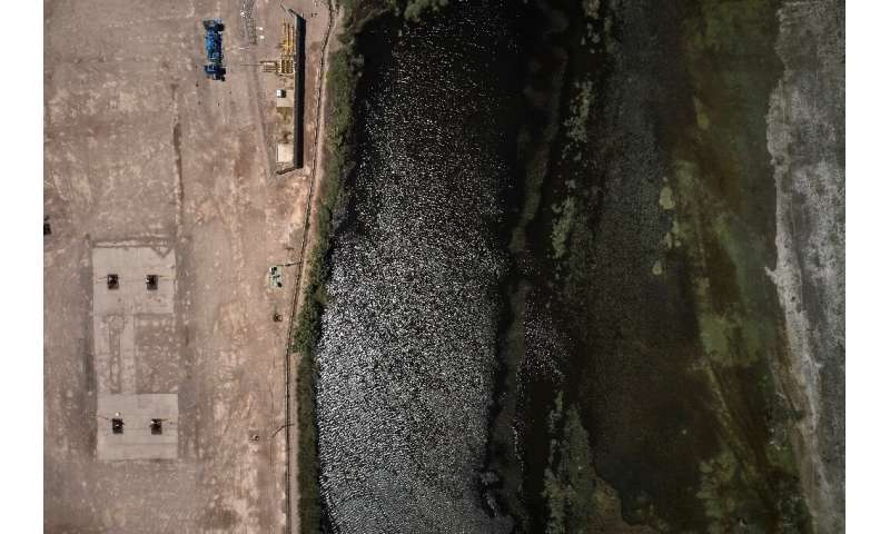 Aerial view of a manifold that collects gas from wells in a rural area around the community of Allen, where farmworker Roxana Va