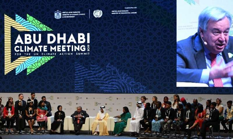 UN Secretary General Antonio Guterres (C) and Emirati ministers chair a panel at the Abu Dhabi climate meeting in Abu Dhabi
