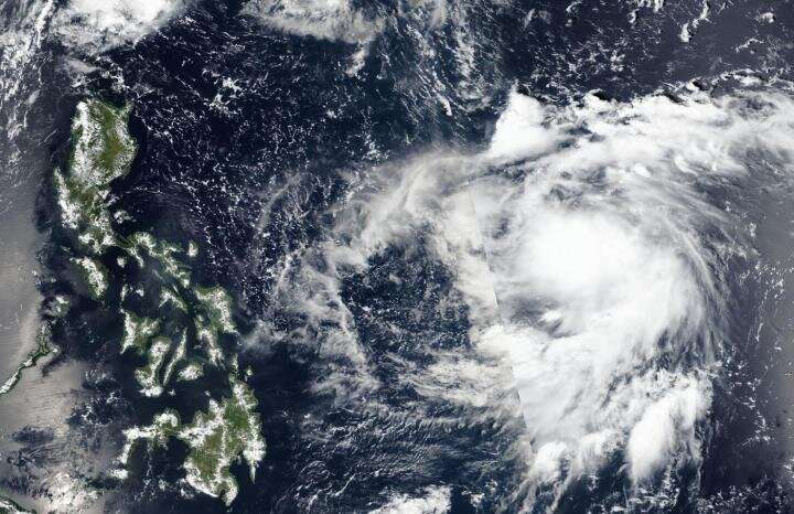 NASA-NOAA satellite sees Tropical Depression 19W organizing
