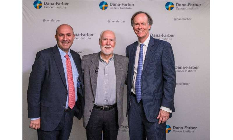 Cancer patient Shaun Tierney (C) is seen here with his doctor Toni Choueiri (L) and Nobel prize winner William Kaelin (R) at the