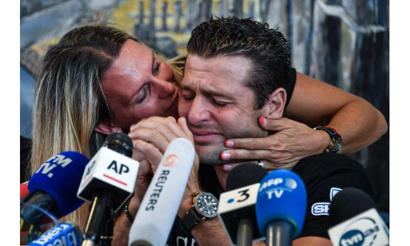 Franky Zapata got a peck of encouragement from his wife Krystel after he broke down in tears of emotion at a press conference in