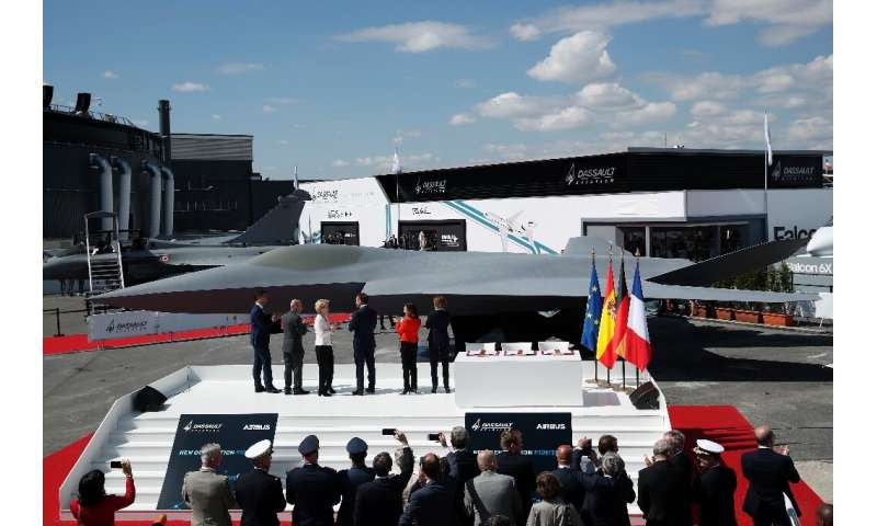 French President Emmanuel Macron, third from right, joined other officials in front of a full-scale model of new jet for Europe'