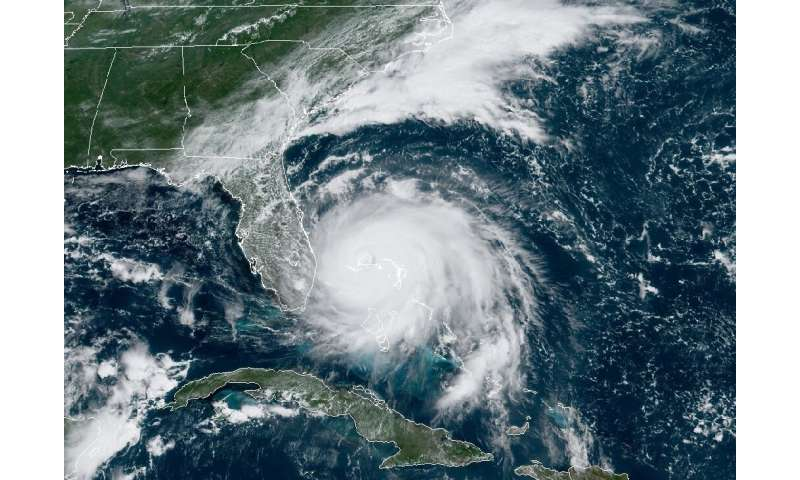Hurricane Dorian broke into the record books on Sunday when its maximum sustained winds of 185 mph (300 kph) tied it in second p