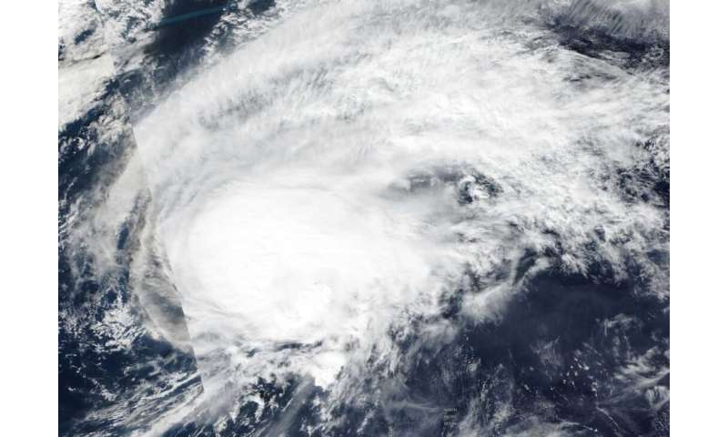 NASA-NOAA satellite finds a weaker, transitioning Tropical Storm Halong
