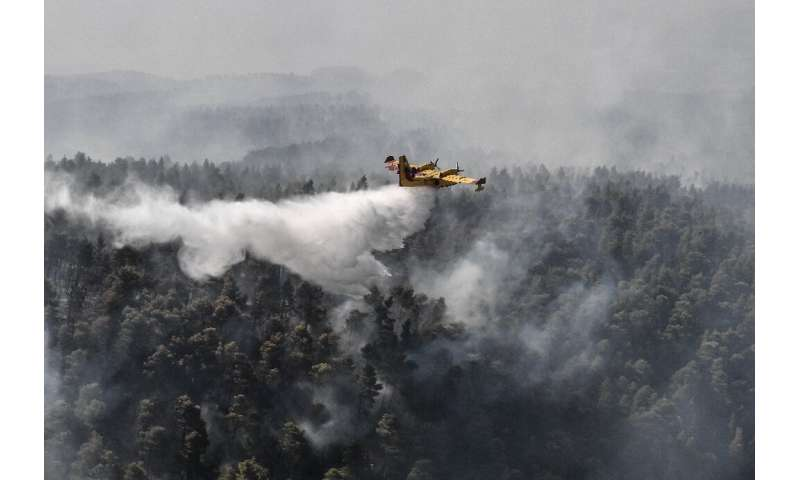 Firefighters managed to contain the fire in a ravine near the village of Platana, backed by nearly 100 vehicles, nine helicopter