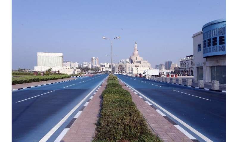 Feeling blue: Qatar road turned azure to cool city