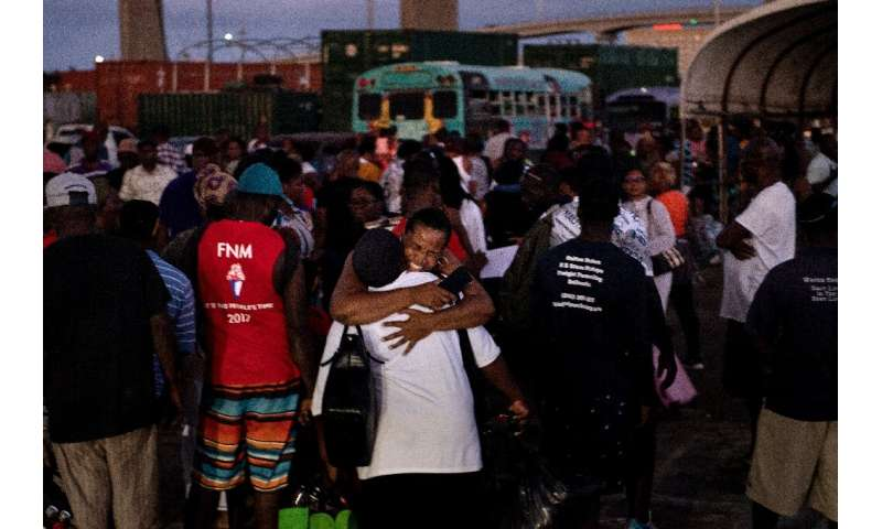 Hurricane Dorian refugees arrive at the Kendal GL Isaacs National Gym on September 6 in Nassau