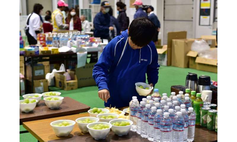 Typhoon Hagibis forced tens of thousands of people to flee their homes, including this boy taking fruit at a shelter in Nagano