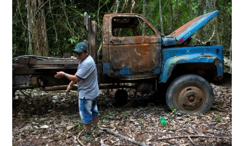 A burnt-out truck found on Arara land was once used to carry illegally acquired timber; then dozens of indigenous people set it