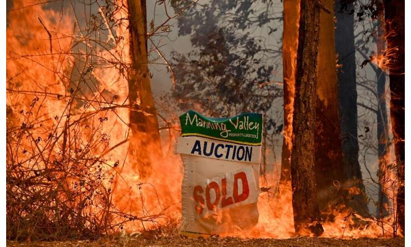 A bushfire burns outside a property near Taree