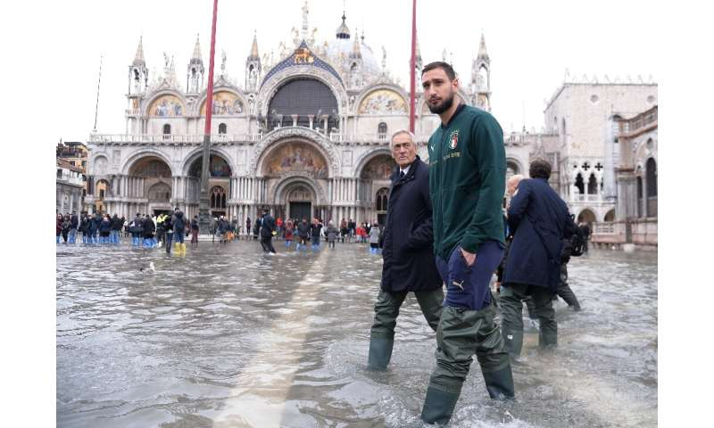 AC Milan goalkeeper Gianluigi Donnarumma waded through flood water in St. Mark's Square