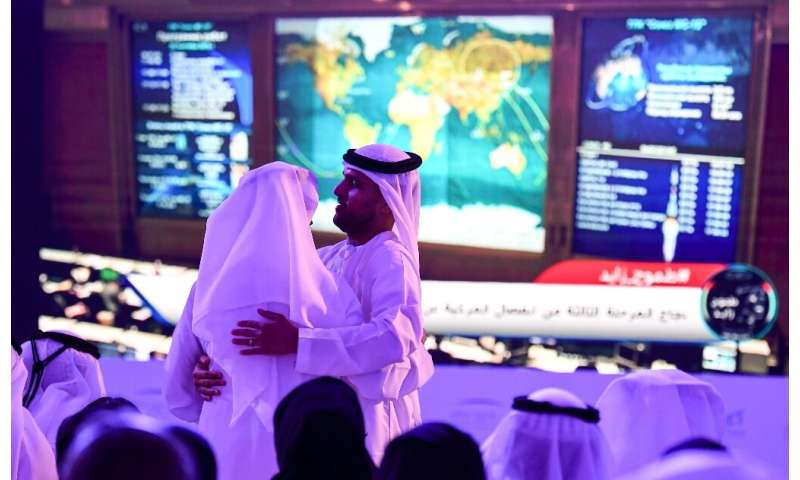 A crowd watches the rocket launch from the Mohammed Bin Rashid Space Centre in Dubai