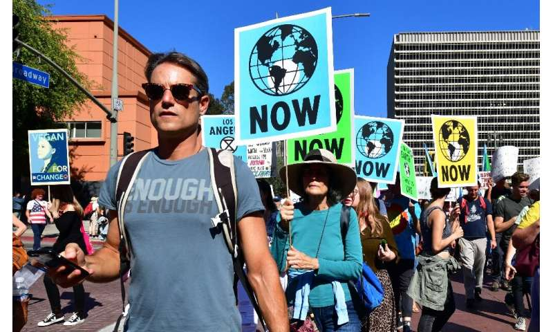 Activists march through downtown Los Angeles in November 2019 in a climate change rally addressed by teenage Swedish activist Gr