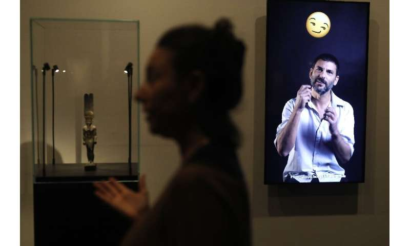 "A curator presents the exhibition ""Emoglyphs: Picture-Writing from Hieroglyphs to the Emoji"" at the Israel Museum in J"