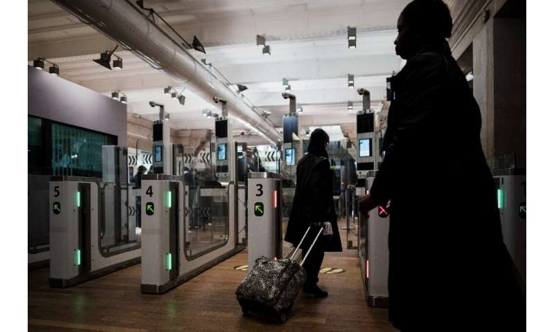 A Eurostar passenger going through an automated ePassport gate equiped with a facial recognition system the gare du Nord in Pari