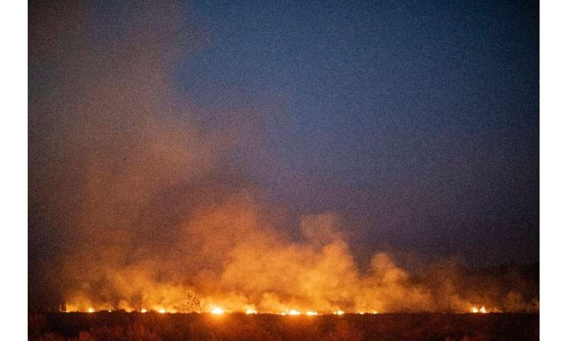 A forest wildfire spreads onto a farm in the municipality of Nova Santa Helena, in Brazil's Mato Grosso state, in the southern A