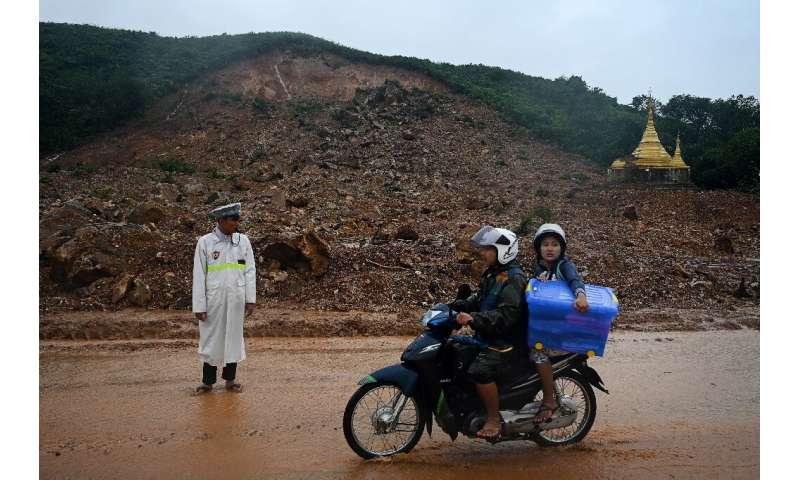A huge brown gash on the hillside marked where the deluge of mud descended on Ye Pyar Kone village in Mon state on Friday