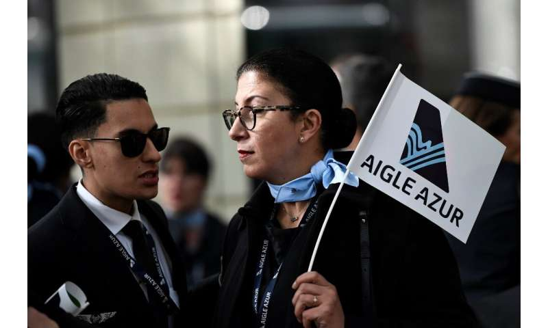 Aigle Azur employees rallied outside the French Transport Ministry in Paris on Monday, urging the government to help safeguard t