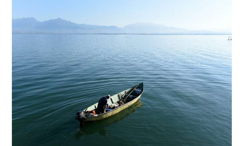 Albanian fishermen and experts are alarmed by overfishing and poaching on the Balkans' biggest lake, Shkodra