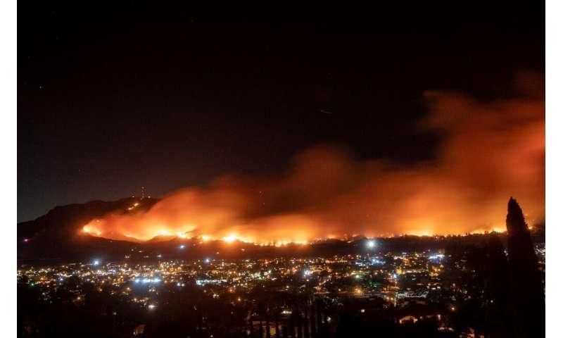 A long exposure photo shows the Maria Fire as it races across a hillside in Santa Paula, California on November 1, 2019