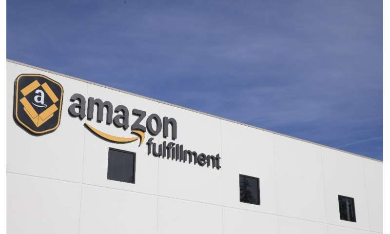 Amazon, known for its use of robotics in its warehouses such as this one in DuPont, Washington, said it would offer training to