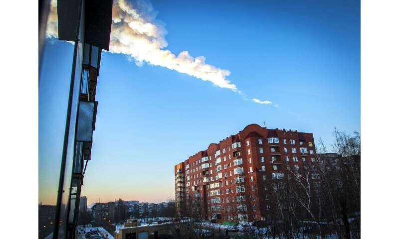 A meteorite trail is seen above a residential apartment block in the Urals city of Chelyabinsk, on February 15, 2013