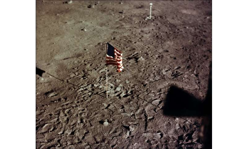 A NASA photo taken on July 20, 1969 shows the US flag and the footprints of astronauts Neil A. Armstrong and Edwin E. Aldrin on