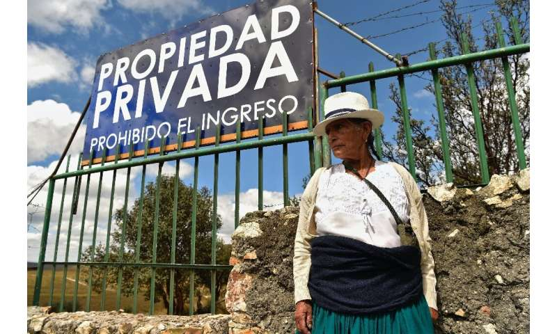 An Ecuadorean indigenous woman stands in protest outside a mining concession in Quimsacocha, Azuay province, Ecuador
