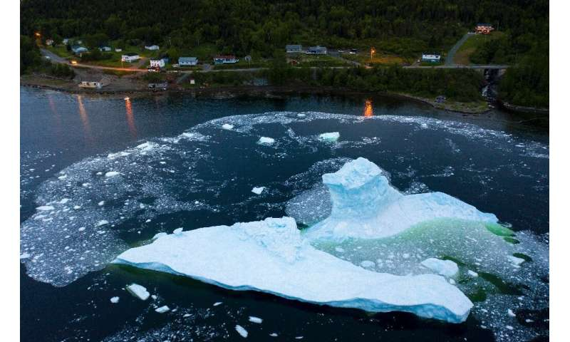 An iceberg collapses near Canada's east coast at King's Point in Newfoundland, which has a front row seat to the consequences of