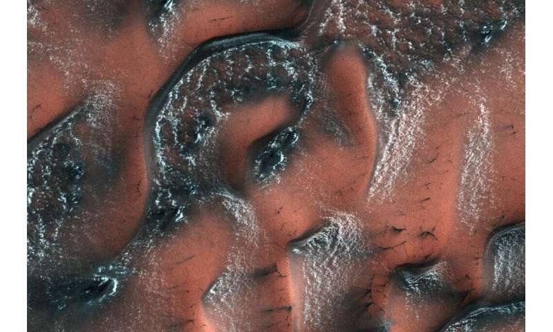 An image from NASA's Mars Reconnaissance Orbiter shows snow and ice accumulated during winter covering dunes in the planet's nor