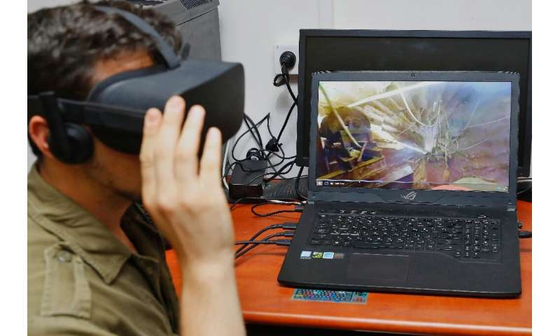 An Israeli soldier takes part in an underground combat simulation using virtual reality (VR) technology, at an army base in Peta
