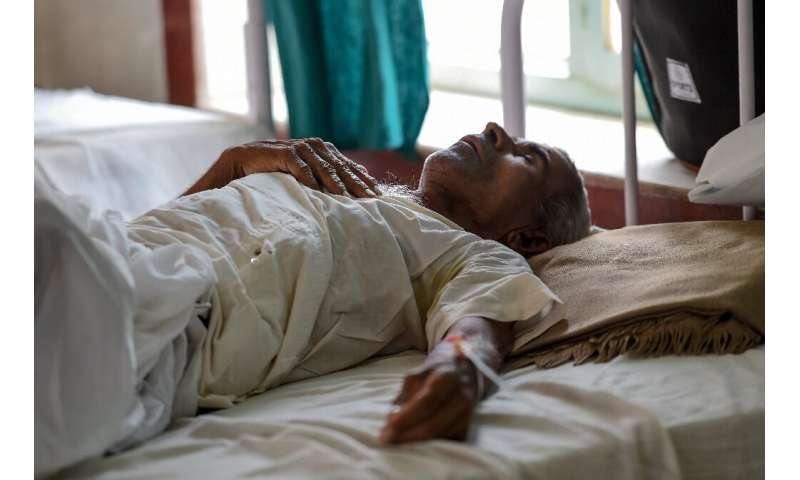 A patient stricken by heat exhaustion recovers in a hospital in Churu, Rajasthan where temperatures have hit 50 degrees Celsius