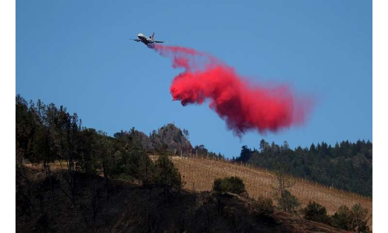 A plane drops fire retardant ahead of the Kincade Fire on October 29 in Healdsburg, California