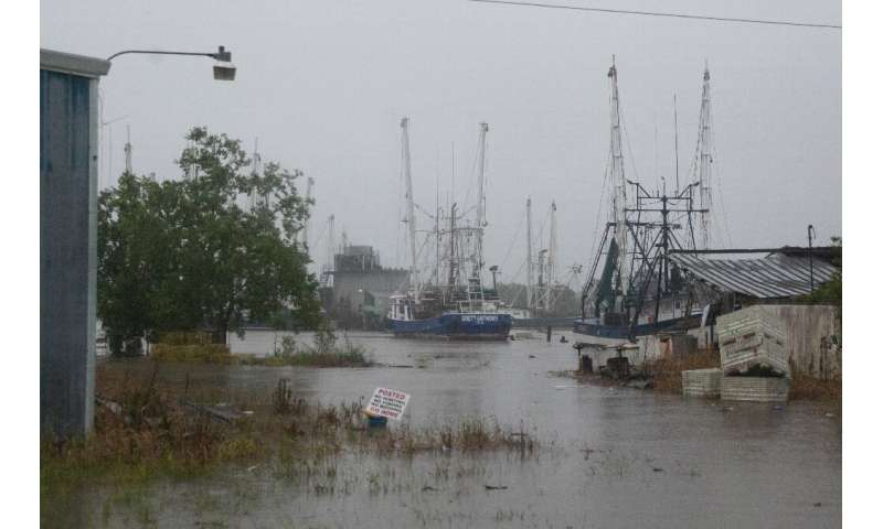 A port floods as Tropical Storm Barry makes landfall in Intracoastal City, Louisiana on July 13, 2019
