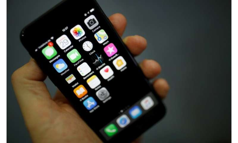 Apple said revenue from iPhone sales dropped by 15 percent from a year ago but did not offer details on unit sales