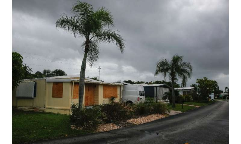 A residence in a mobile home park in Jensen Beach, Florida, was boarded up on September 2, 2019; the area is under a mandatory e