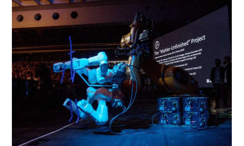 "A robot stands on stage during the ""Mahler Unfinished Project"" at the Ars Electronica in Linz,  Austria"