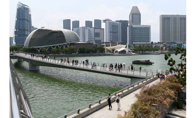 "As a low-lying island, Singapore is especially vulnerable to the ""grave threat"" of rising sea levels, Prime Minister L"