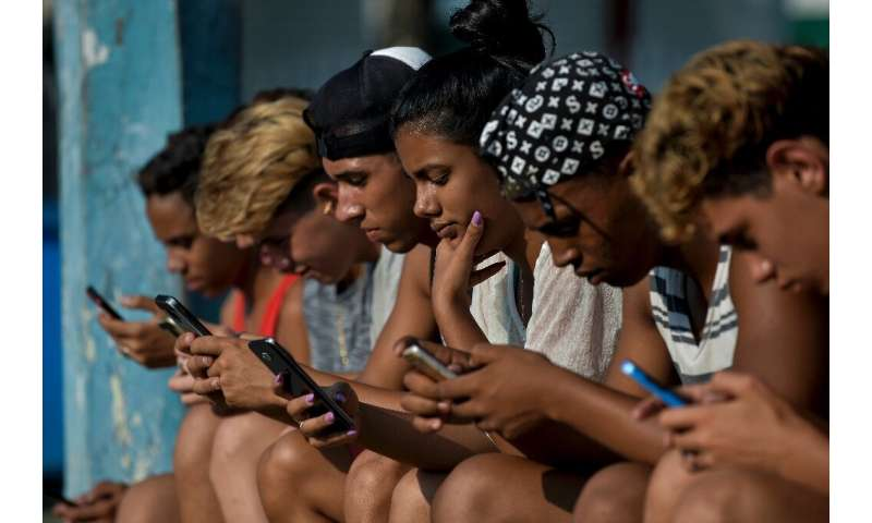 As Cubans like these young people seen recently in Havana enjoy increasing internet connectivity, the government plans to mainta