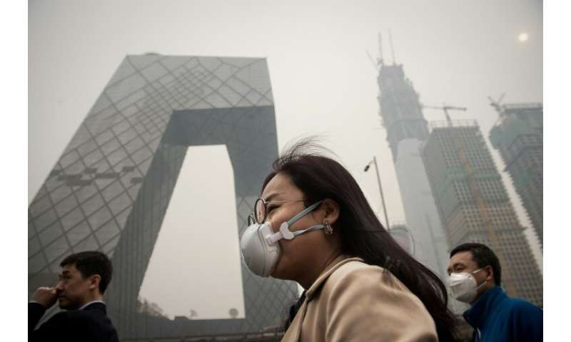 A smoggy day in Beijing. Executives with families are often unwilling to put their children's health at risk for a job.