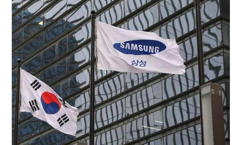 A South Korean flag flies alongside a Samsung one outside the company's headquarters in Seoul