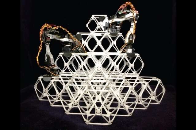 Assembler robots make large structures from little pieces