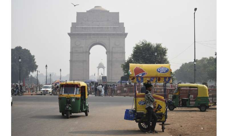 A thick smog engulfed Delhi's landmarks such as the capital's India Gate