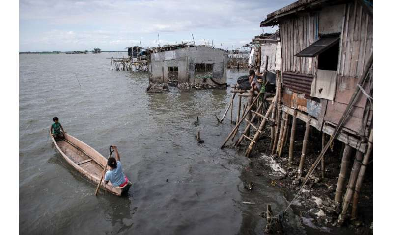 At least 5,000 people have been forced out of the mostly rural coastal areas north of Manila in recent decades as the bay water