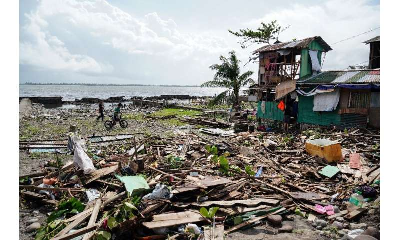 At least 50 people are now known to have died in a powerful typhoon that raked the Philippines over Christmas
