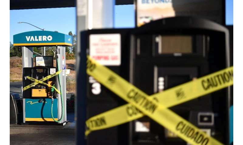A Valero gas station sits vacant after power was shut down as part of a statewide blackout in Santa Rosa, California