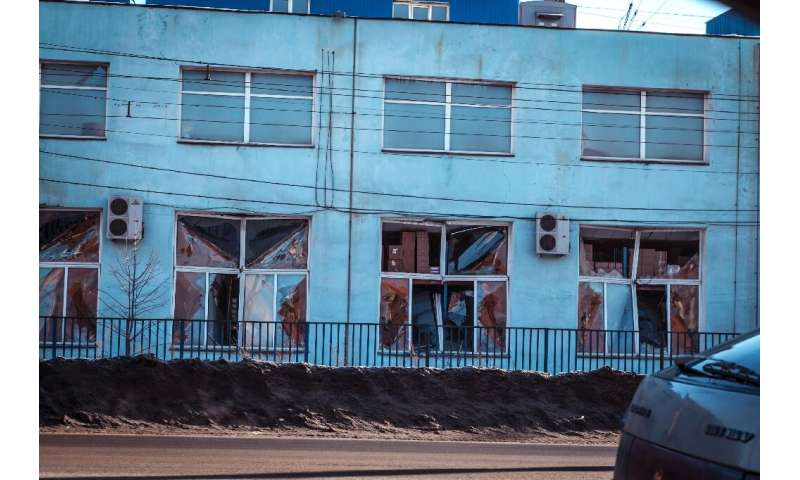 A view of the facade of a local paint and varnish plant damaged by a shockwave from a meteor in the Urals city of Chelyabinsk on