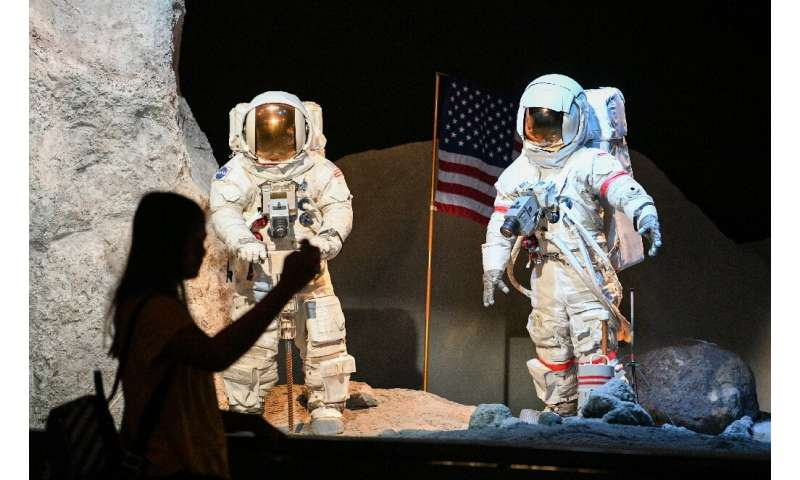 A visitor looks at a lunar landscape exhibit during the Apollo 11, 50th Live celebration at Space Center Houston in Houston, Tex