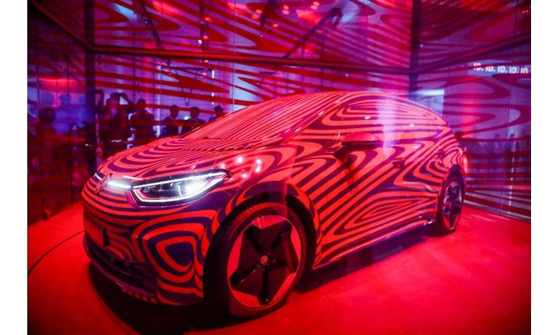 A Volkswagen ID 3 electric car is seen in a glass cage during a press conference in Berlin on May 8, 2019