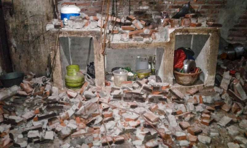 A wall of a village house collapsed after a strong earthquake hit Sukasari in Lebak, Banten province